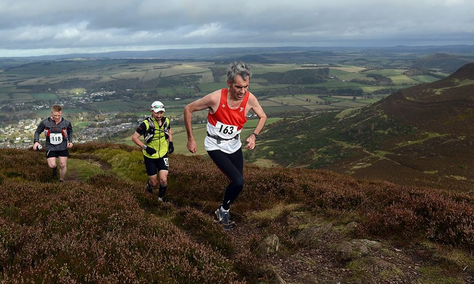 Reaching the top of the Eildon Hills with Steven Beattie - in grey top (Photo courtesy of Border Telegraph)